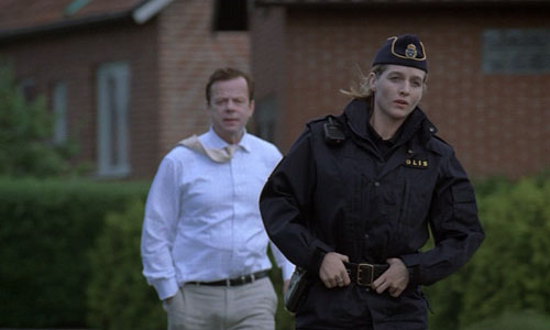 Kurt Wallander (Krister Henriksson) and Linda (Johanna Sällström) at the beginning of Before the Frost when Linda has just graduated from the police college.