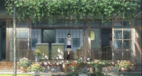 Makoto at home (eating a 'pudding').