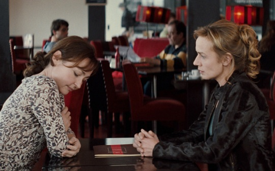 Claire (Sandrine Bonnaire, right) confronts Elsa (Catherine Frot, left) in Mark of Angel
