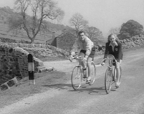 Sam (Patrick Holt) and Sue (Honor Blackman) out riding with the Wakeford Wheelers.