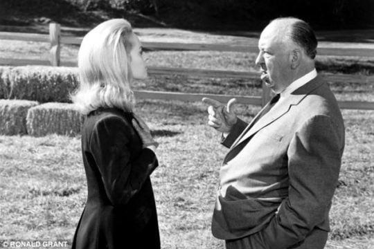 Tippi Hedren and Alfred Hitchcock in on the set of 'Marnie' (note that Hitchcock was slightly taller than Hedren, whereas Toby Jones is shorter than Sienna Miller)