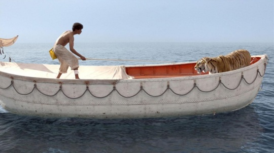 Pi (Suraj Sharma) attempts to tame the tiger.
