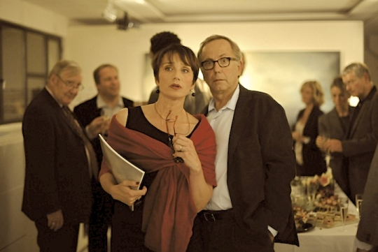 Jeanne (Kristin Scott Thomas) and Germain (Fabrice Luchini) are the couple seduced by Claude's storytelling.