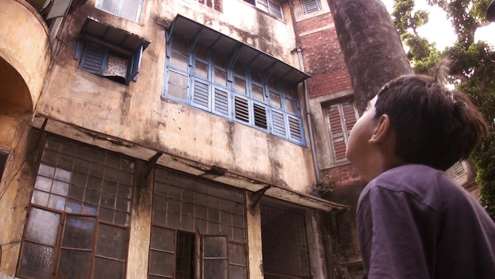 Sarthak's son looks up at the old house