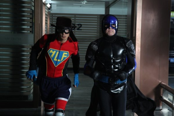 The pair dressed as superheroes – HLF refers to the Maoist era 'hero' figure Lei Feng.