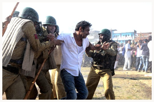 Ajay Devgn in one of several scenes of protests broken up by the local police