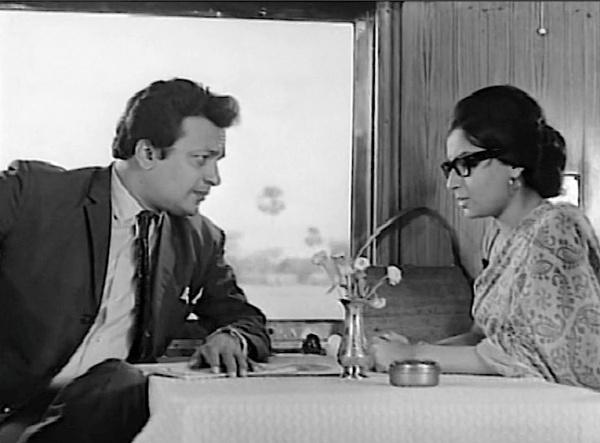 Andiram and Aditi meet in the dining car.