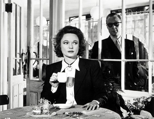 Marius Goring as the German intelligence chief approaches Anna Neagle as Odette