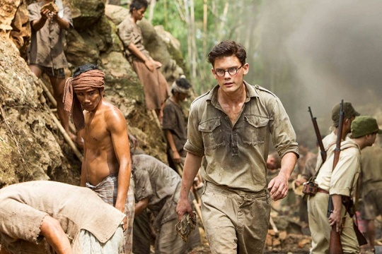 The young Eric Lomax (Jeremy Irvine) when he first arrives at the railway camp.