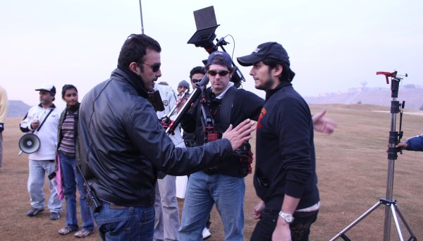 On the shoot for WAAR, lead actor Shaan Shahid is on the left and director Bilal Lashari on the right.