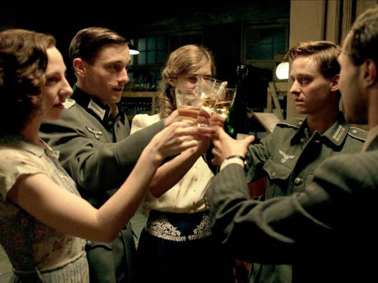 Five friends toast to their future in Berlin in the summer of 1941