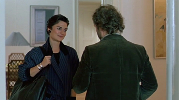 . . . and with the American record label representative (played by Cristine Rose) in an apartment in West Berlin