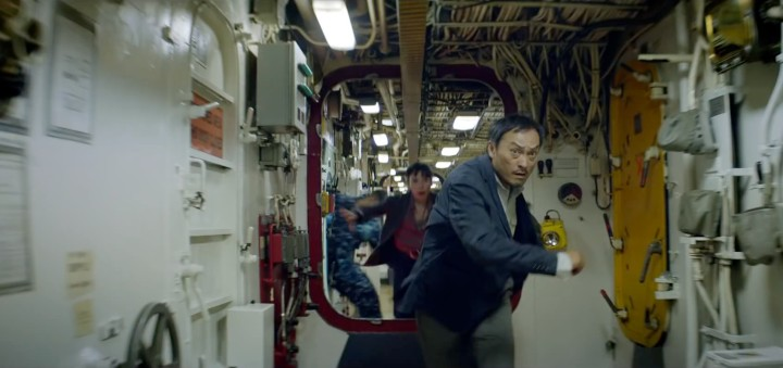 Ken Watanabe and Sally Hawkins as the engineer and scientist rushing to the deck of a US Navy ship to see Godzilla