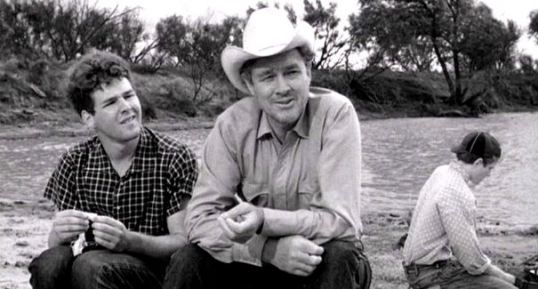 Timothy Bottoms as Sonny with Ben Johnson as Sam (in the hat). Sam Bottoms as Billy is in the background.