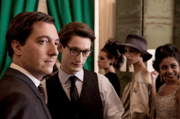 Pierre Bergé  (Guillaume Gallienne) and Yves Saint Laurent (Pierre Niney) in the dressing room for a fashion show.
