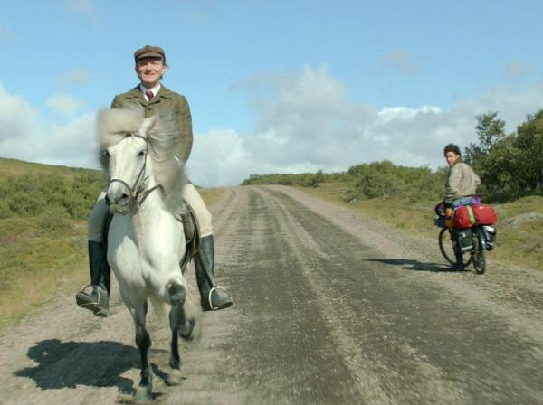 Ingvar E. Sigurðsson plays the lone farmer who proudly trots his mare down the road watched by a visitor from Latin America.