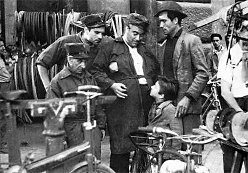 Antonio and Bruno ask their friends to help them look for the stolen bike in BICYCLE THIEVES
