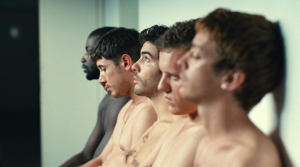An emphasis on bodies – the young men during the recruitment process for new workers in the plant. Gary (Tahar Rahim) is in the centre of the group.
