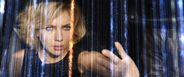 Scarlett Johansson as 'Lucy' in superhero mode sorting through thousands of phone conversations on a Paris street
