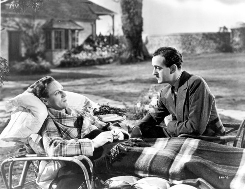 An ailing R. J. Mitchell (Leslie Howard) visited by test pilot Crisp (David Niven)