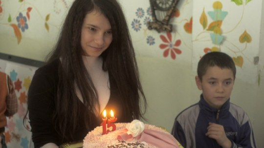Georgiana with her birthday cake and one of her younger brothers.