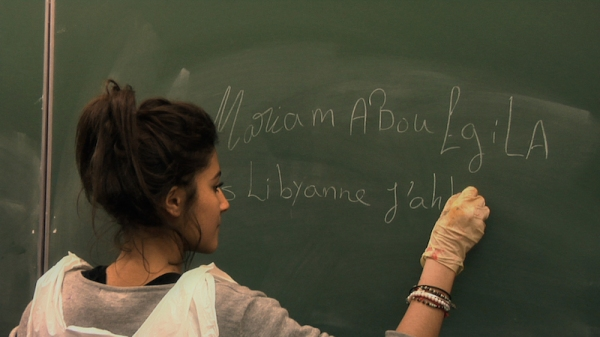 Mariam, a Libyan girl who has been living in Egypt attempts to write in French at the start of SCHOOL OF BABEL. photo courtesy New Wave Films