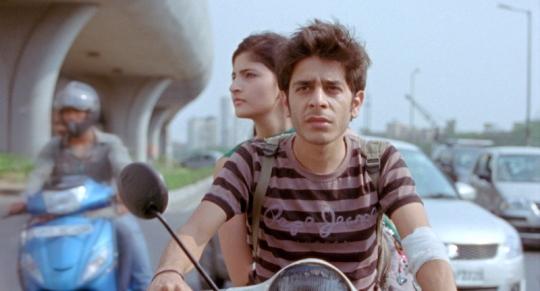 Titli on his scooter with his wife Neelu (Shivani Raghuvanshi)