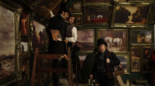 Turner in the main gallery of the Royal Academy where the artists continued to work on paintings after they were hung.