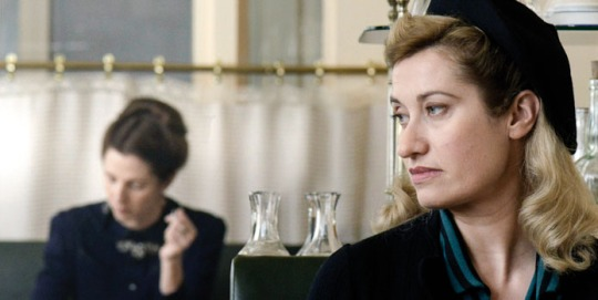 Violette (Emmanuelle Devos) in the foreground with Simone de Beauvoir (Sandrine Kilberlain) in the background.