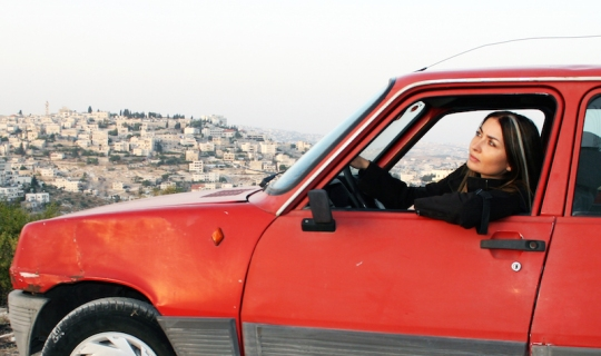Writer-director Leila Sansour in her battered car.