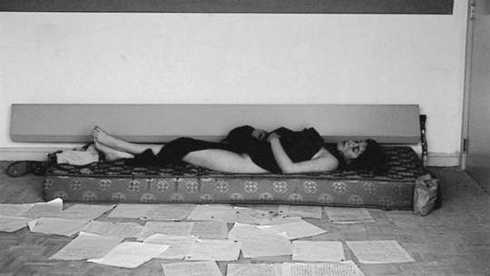 'Julie' on the mattress with her 'letters' on the floor.