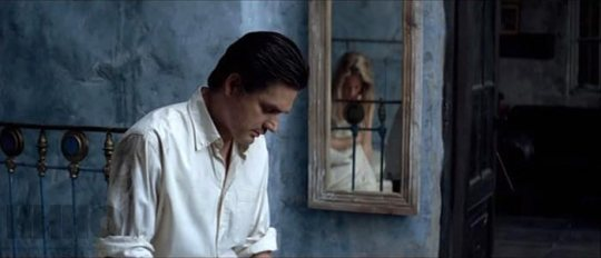 Alex (Konstantin Lavronenko) with Vera (Maria Bonnevie)  'caught' in the mirror's reflection.