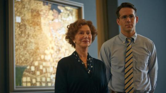 Helen Mirren and Ryan Reynolds pose before a reproduction of the painting.