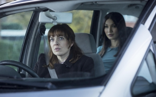 Laura Hawkins (Katherine Parkinson, left) and in the back seat her 'synth' Anita (Gemma Chan)