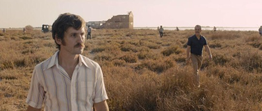 Pedro (Raúl Arévalo, nearest camera) and Juan (Javier Gutiérrez) out in the marshes
