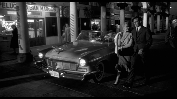 Mike Vargas (Charlton Heston) and his wife Susan (Janet Leigh) walk alongside the car with the bomb in the opening long take (fromhttp://www.dvdbeaver.com/film/DVDCompare2/touchofevil.htm)