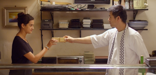 Juana (Diana Elizabeth Torres) and Aki (Yutaka Takeuchi) 'out front' in the sushi restaurant 'Osaka'