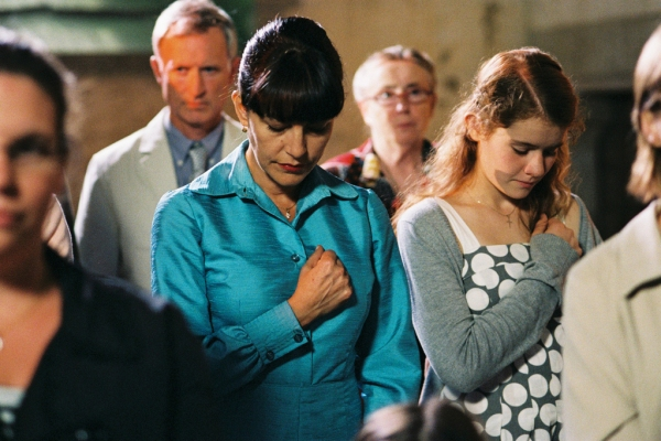 Anna with her mother in church.