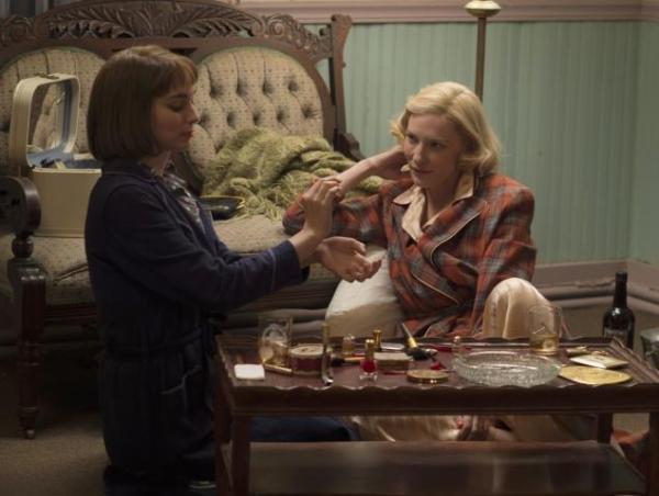 Therese and Carol share Carol's perfume . . .