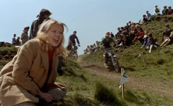 Hayley Mills as Jenny enjoys the motorbike scrambling event that she is taken to by her husband's brother who is a competitor.
