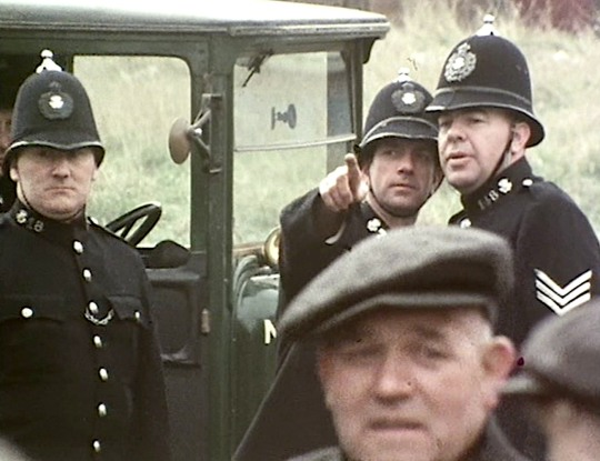 The police arrive in a Durham pit village to arbitrarily arrest striking miners under Emergency Powers legislation in 1921. A shot from DAYS of HOPE Part 2.