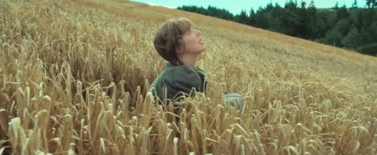 Chris (Agyness Deyn) risesin the field of barley in the opening shot of Sunset Song