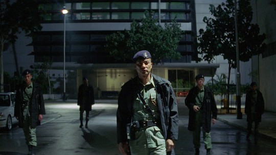 Sergeant Mike Ho (Simon Yam) leads his PTU squad – here waiting for a final shoot-out