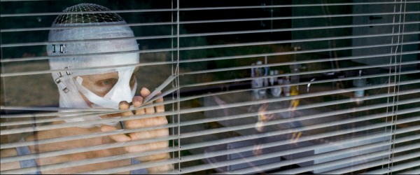 The mother looks through the blinds . . .
