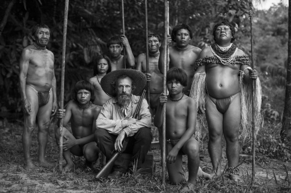 An image that might have come from an ethnographic account of a journey in the early 20th century. Jon Bijvoet as Theo, the earlier of the two 'whites' to travel upstream, poses with a group of local people.