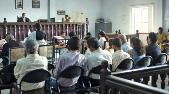 Courtroom scenes (and many outdoor scenes) are sometimes seen in long shot.