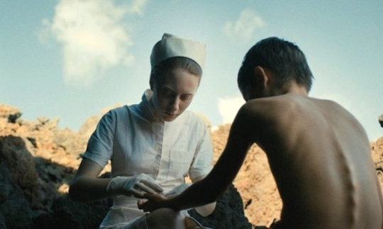 Stella (Roxane Duran) first meets Nicolas when he cuts himself on a rock.
