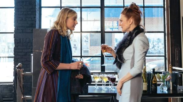 Maggie goes to a book launch by Georgette (Julianne Moore)