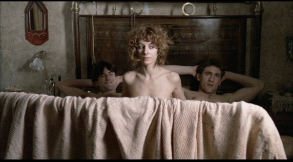 Stefania Casini as Neve in bed with both Olmo and Alfredo