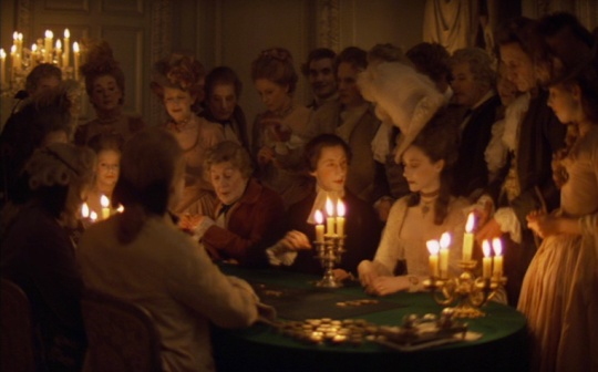 One of Alcott's interiors lit by candles. Lady Lyndon ( Marisa Berenson) at the card table with her son's tutor and the family chaplin Rev. Runt (Murray Melvin)